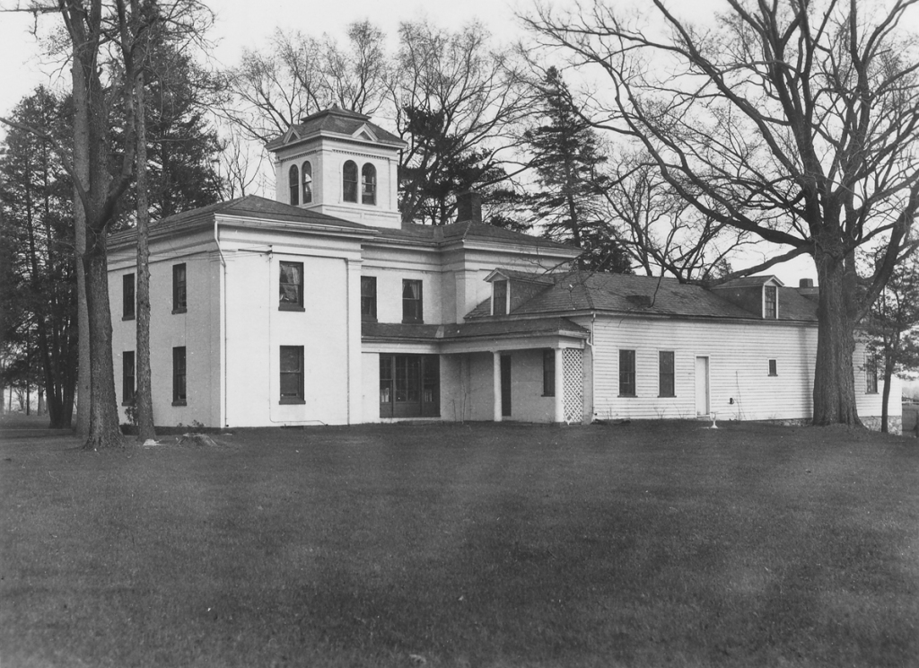 Prevel Hall on the campus of Saint Michael's College.  Stoehr lived for many years in a single room behind the dark French doors on the first floor.